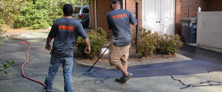 The Pro Contracting Services team sealing asphalt